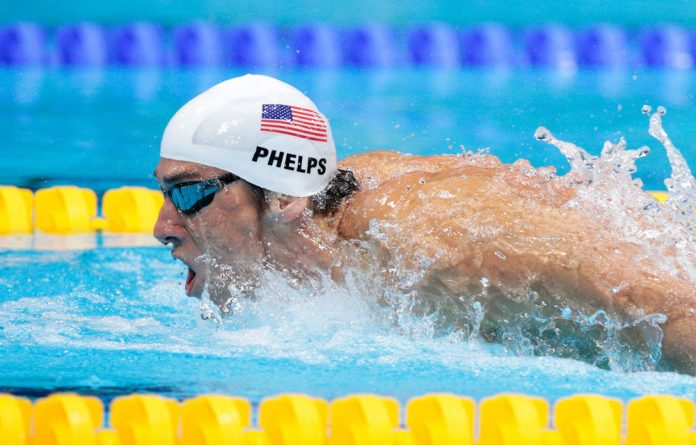 Michael Phelps swims butterfly as he competes in heat four of the Men's 400m Individual Medley on day one of the London 2012 Olympic Games.