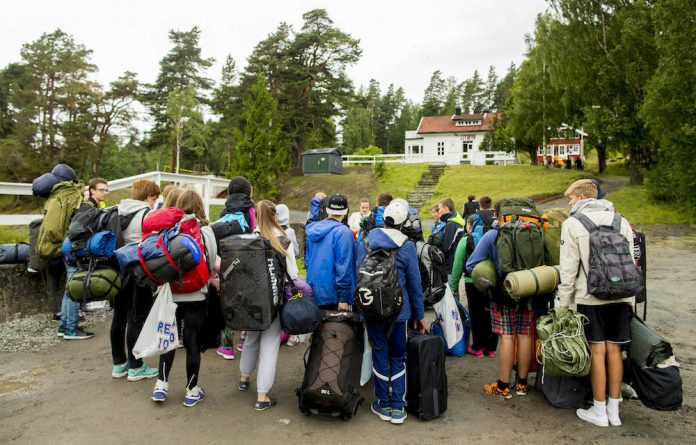 Moving on: Youths arrive on Utøya for a summer camp