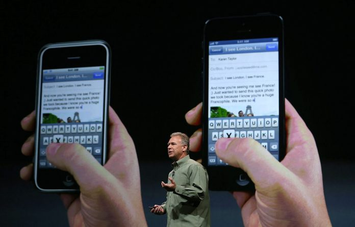 Apple's Phil Schiller announces the new iPhone 5 during an Apple special event at the Yerba Buena Centre.