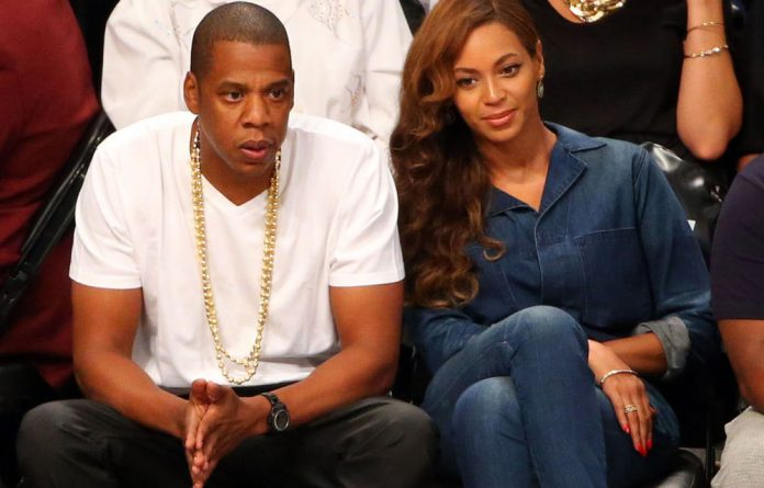 Jay-Z and Beyoncé sitting courtside at the basketball game between the Brooklyn Nets and Miami Heat on May 12.