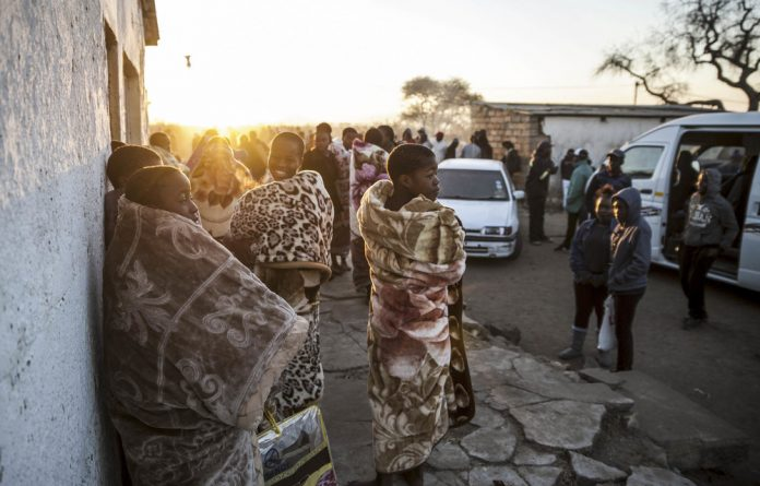 Rite of passage: Girls from Moleti in Limpopo are welcomed back after a six-week initiation to prepare them for their journey into womanhood. Photo: Gallo Images/The Times/Madelene Cronjé