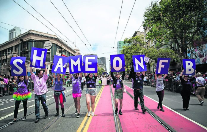 Shamed: San Francisco Pride marchers protest against Facebook's policy on using 'anonymous' names.