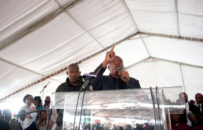 Julius Malema addresses the mourners at a memorial for the dead Lonmin miners.