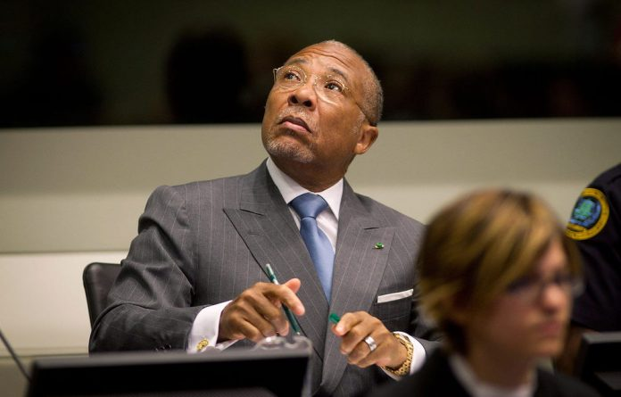 Former Liberian president Charles Taylor waits for the start of the sentencing hearing in Leidschendam