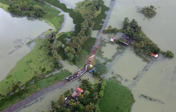 An aerial view shows partially submerged road at a flooded area in the southern state of Kerala