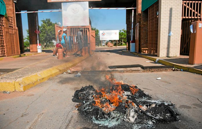 Tyres are burnt in protests over student funding at the Tshwane University of Technology.