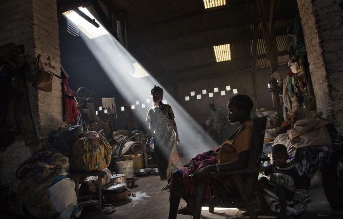 People displaced by the fighting between warring forces in the Central African Republic find shelter in an old factory on the grounds of the Catholic church in Bossangoa.
