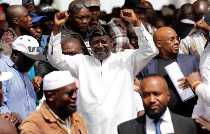 Raila Odinga after being sworn in as the people's president.