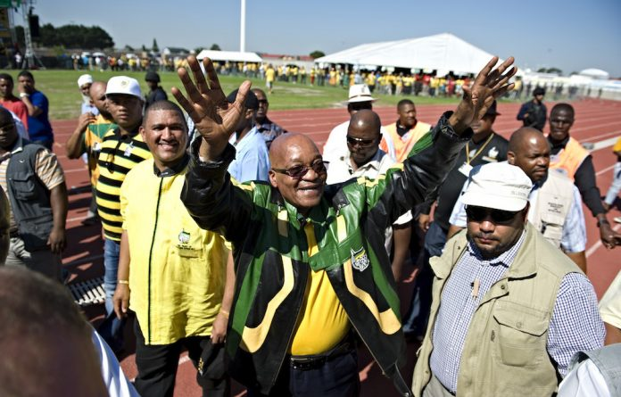 No problem: Jacob Zuma's dancing and giggling might not only be a way of endearing himself to others but is also a way of deflecting attention away from the issues haunting him.