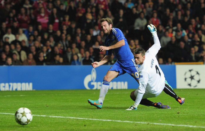Juan Mata of Chelsea fires the ball past Jesper Hansen of FC Nordsjaelland to score during the Uefa Champions League match between FC Nordsjaelland and Chelsea.