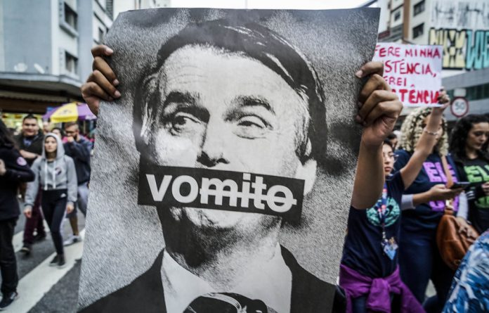 Not him: Brazilians demonstrate against right-wing President Jair Bolsonaro. Photo: Pablo Albarenga/ Getty Images
