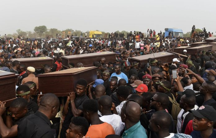 Mourners carry the coffins of the men who were burnt alive in broad daylight through Ibrahim Babangida Square in Benue. The men were burnt to death allegedly because they looked like Fulani herders.