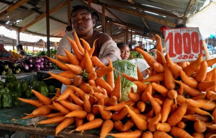 A vendor at the Sigida Market