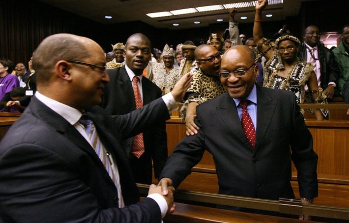 Case closed: Jacob Zuma is congratulated by his attorney Michael Hulley after being found not guilty of rape by Judge Willem van der Merwe in the Johannesburg high court.