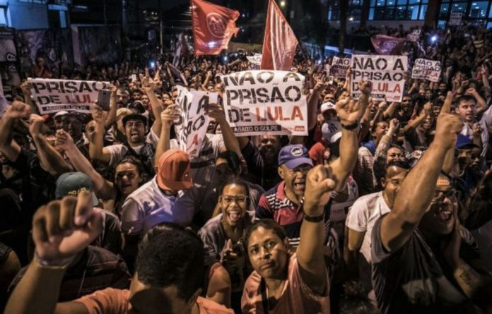 Supporters protest against former president Lula da Silva's 12-year prison term. The popular leader's absence from the ballot in October's elections has left the field wide open.