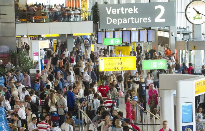 Authorities have evacuated parts of Amsterdam's Schiphol airport after workers found an unexploded World War II bomb underground near a busy terminal.