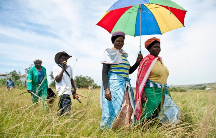 Residents walk to a community meeting on the proposed mining in Xolobeni