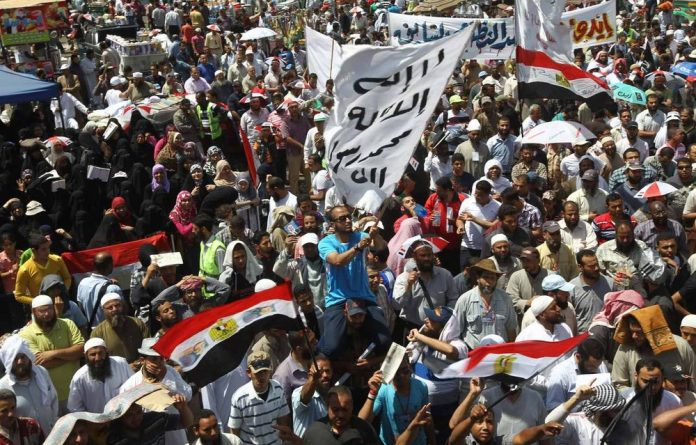 Protesters pictured in Cairo's Tahrir Square where a number of female reporters have been assaulted.