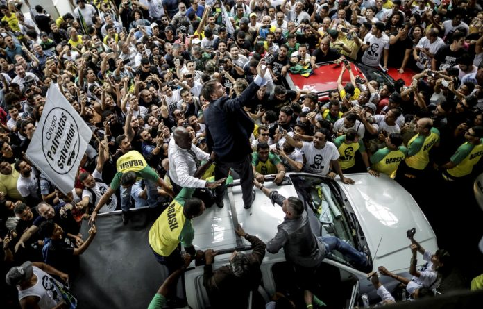 Former army captain Jair Bolsonaro stands for the militarisation of the state combined with extreme free-market policies.