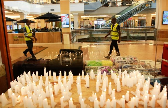 Candles in memory of those killed in Nairobi's Westgate Mall attack in September 2013.