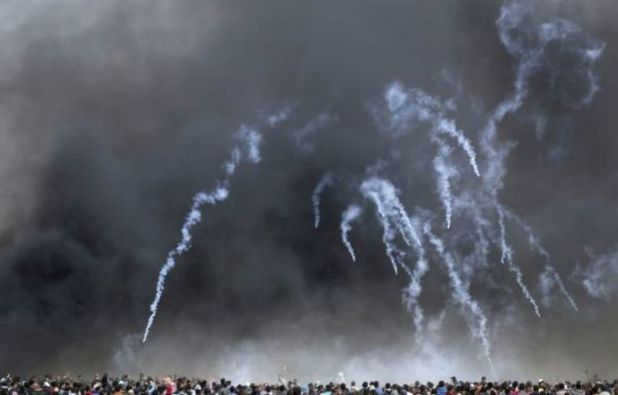Israeli troops fire tear gas at Palestinians at a peaceful march for their return to their homeland. May 15 commemorates the mass eviction of Palestinians from their land.