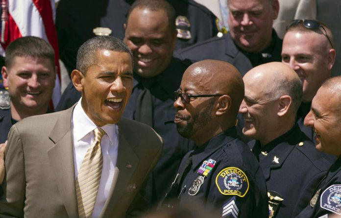President Barack Obama greets recipients of the Top Cops award during a ceremony in the Rose Garden at the White House on May 12.
