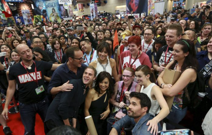 Agents of S.H.I.E.L.D. cast members pose with fans at the 2014 Comic-Con International Convention in San Diego on Saturday.