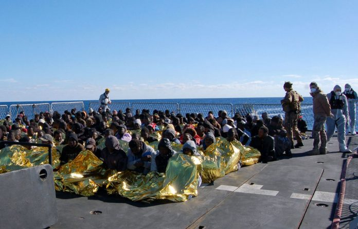 Migrants on a Marina Militare vessel during a rescue operation by the Italian navy off the coast of Sicily.