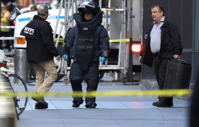 A member of the New York Police Department bomb squad is pictured outside the Time Warner Center in the Manhattan borough of New York City after a suspicious package was found inside the CNN Headquarters in New York.