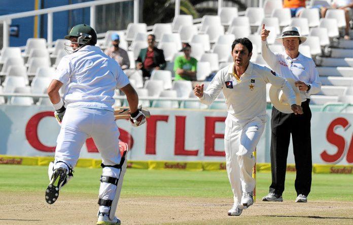 Pakistan's Saeed Ajmal celebrates taking the wicket of Jacques Kallis.