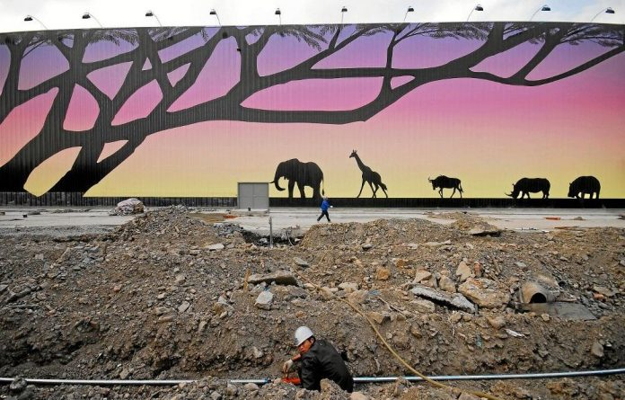 A labourer works at the construction site of the Africa pavilion at the 2010 World Expo site in Shanghai. Chinese business in Africa has drawn a lot of criticism.