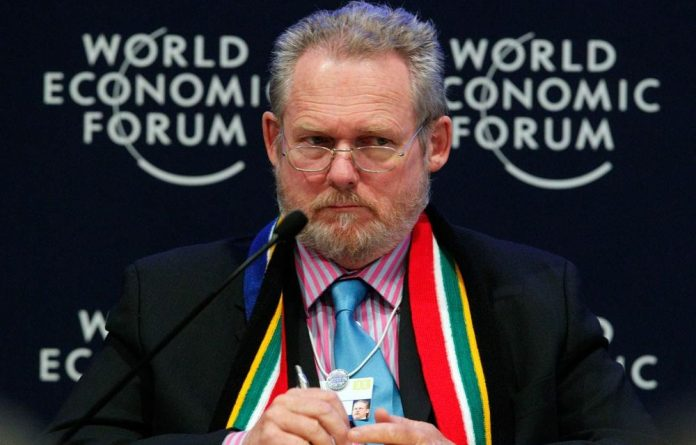 Trade and Industry Minister Rob Davies attends a session at the World Economic Forum in Davos.