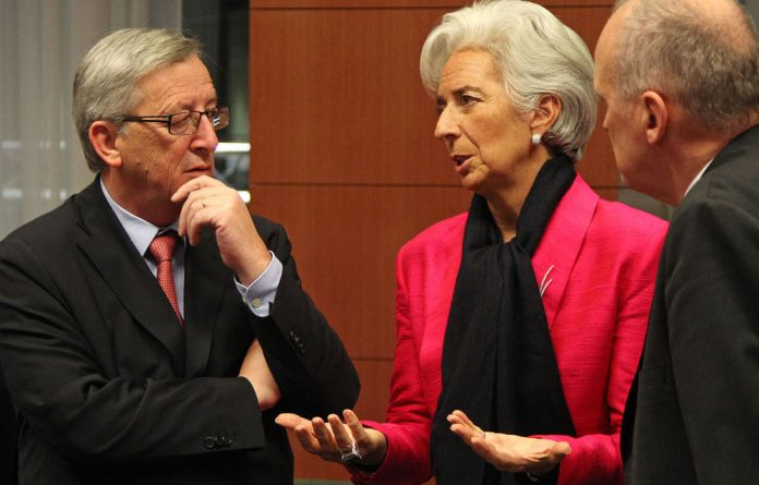 IMF managing director Christine Lagarde talks with Luxembourg's Prime Minister and chairperson of the Eurogroup Jean-Claude Juncker