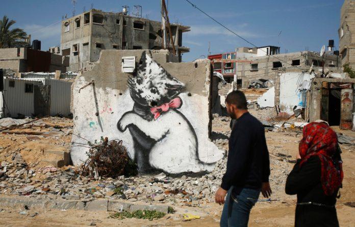 A mural of a playful-looking kitten