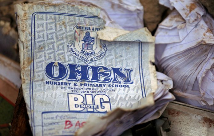 A notebook is pictured at the site of a collapsed building containing a school in Nigeria's commercial capital of Lagos