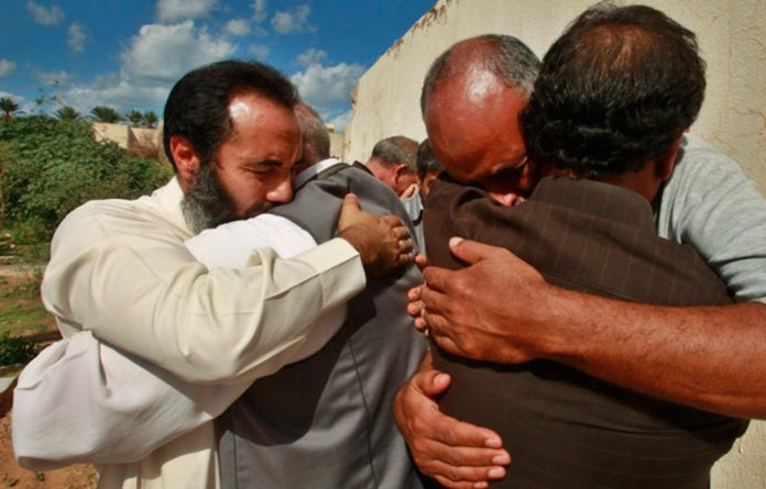 Mourners at the funeral of anti-Gaddafi fighter Fawzi al-Maghbor from 2011. Libya scores highest in Africa in 2015's World Happiness Report.