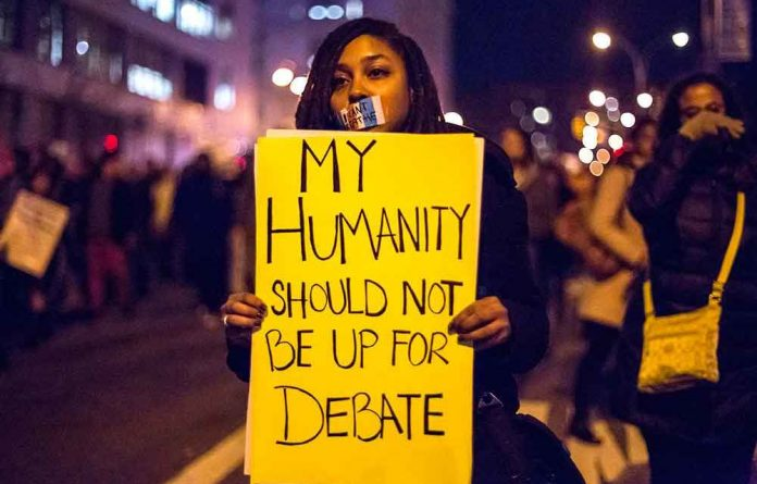 A protester denounces the recent spate of white police officers shooting unarmed black people.