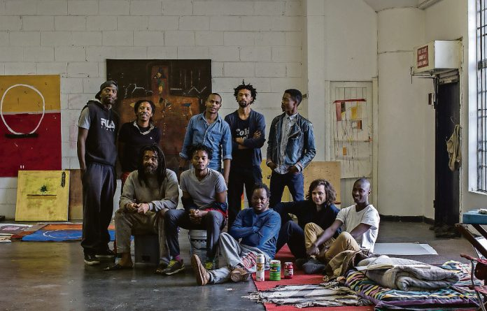 Some of the residents of the relaunched August House gather in artist Samson Mnisi's studio.