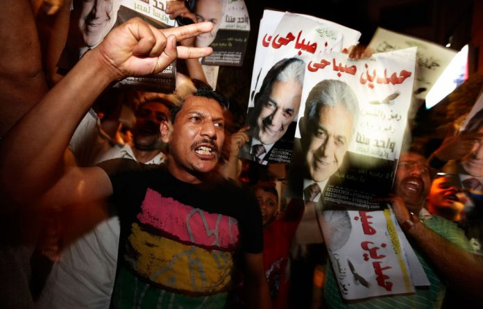 Supporters of Egyptian presidential candidate Hamdeen Sabahi shouts pro-Sabahi slogans at a press conference at Hamdeen Sabahi campaign headquarters in Cairo.