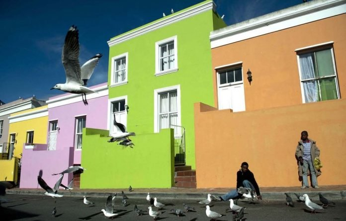A family outside its Wale Street home in the Bo-Kaap