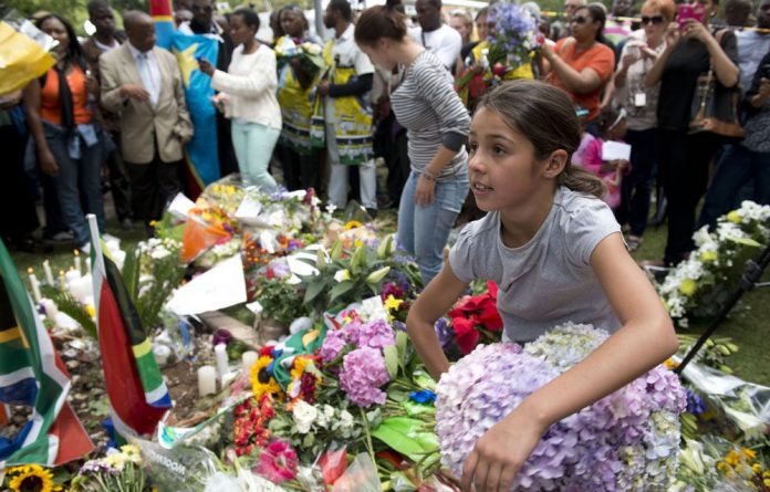 Thousands of people visited Nelson Mandela's Houghton home after the announcement of his death.