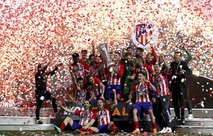 Winner: Atlético Madrid players celebrate as they raise the Europa League trophy after the final against Marseille at Lyon. The club went from being in a near constant state of disarray to being a well-oiled machine.