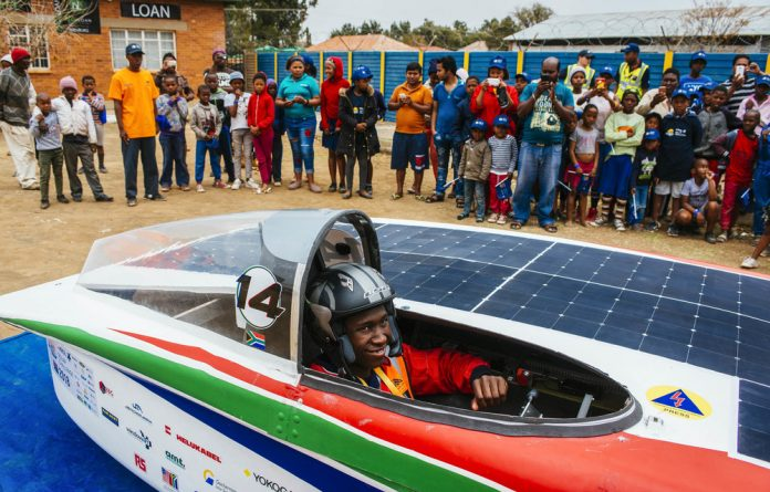 Sunny side up: Bongani Malabele leaves Bloemfontein for Edenburg ahead of the loop stage of the Sasol Solar Challenge.