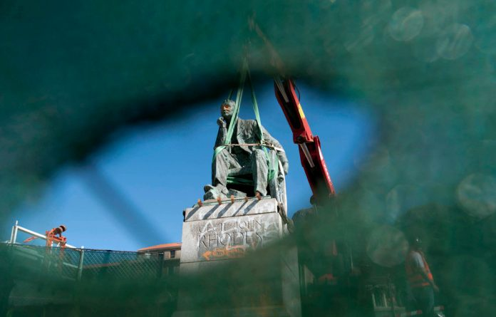 The statue of Cecil John Rhodes is readied for its removal from UCT's campus.