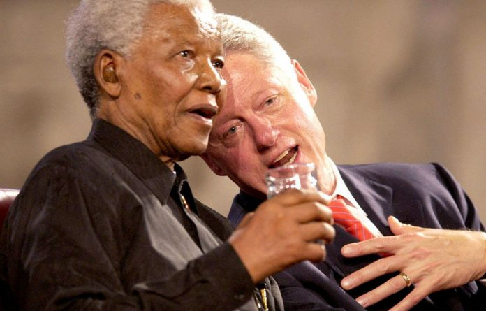 A file photograph of Nelson Mandela with former US President Bill Clinton in 2003. Clinton is set to come to South Africa for Mandela's funeral.