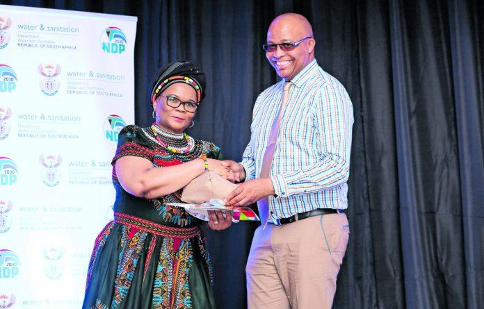 Deputy Minister Pamela Tshwete and Xolisa Roman principal at Unathi Secondary School