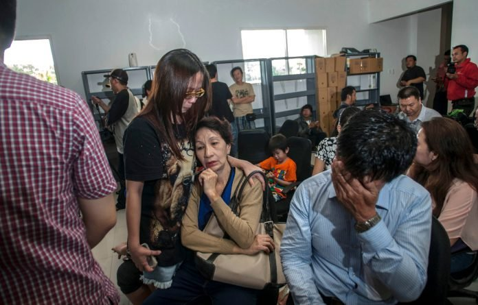 Divers discovered five more bodies belted to seats at the wreckage of the AirAsia Flight that crashed on December 28 2014.