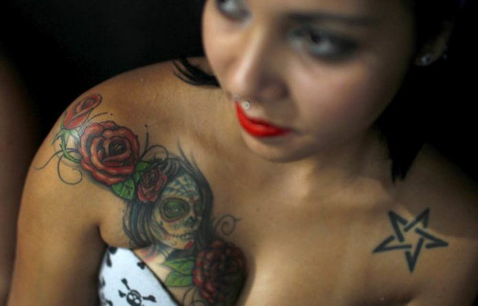 Eye catching: Tattoos are the equivalent of a peacock displaying his plumage or a gorilla beating his chest.