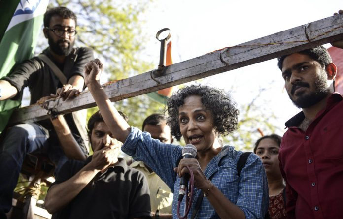 Unsilenced: Arundhati Roy has repeatedly spoken out against the Indian government's policies. She is also sharply critical of capitalism and refuses to deify Mahatma Gandhi.