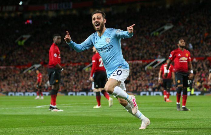 Manchester City's Bernardo Silva celebrates after scoring the opening goal against Manchester United on Wednesday. However
